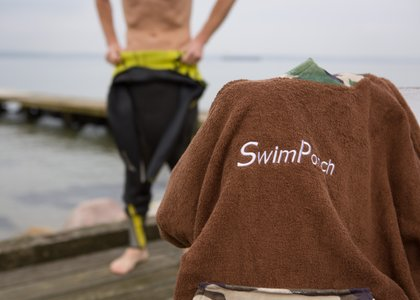 Swimponch keeps you warm and dry when you get out of the water.
